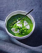 Pea soup with goat's cheese
