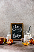 Ingredients for baking. Stay home quarantine isolation period concept. Vintage chalkboard with handwritten chalk lettering Stay home and bake. Grey texture background