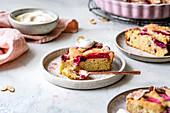 Rhubarb cake with yoghurt on a ceramic plate.