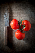 Vine Ripe Tomatoes on a Wooden Background