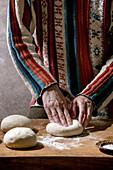 Prepare pizza: knead balls of dough