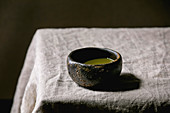 Japanese matcha tea in a ceramic bowl on a table