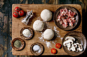 Balls of dough and ingredients for Pizza Napoli