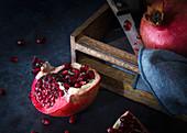 Ripe juicy pomegranate cut in half.