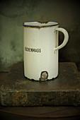 An old enamel measuring jug