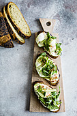 Rocket, zucchini ribbons, sour cream and dukkah on wholegrain bread.