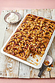 Plum cake with nuts, sliced