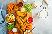Southern fried chicken platter with all the sauces celery and carrots
