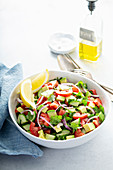 Fresh vegetables chopped salad with tomato, cucumber and avocado