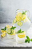 Refreshing lemonade with cucumber in a pitcher