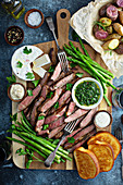 Steak and asparagus platter with potatoes and toast