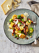 Gnocchi with Brussel sprouts, striped bacon and nuts