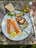 Grilled salmon with eggplant and roasted tomatoes