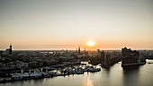 Sunset over tranquil Hamburg cityscape and Elbe River, Germany