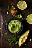 Avocado and whipped feta dip with chopped avocado and lime half