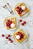 Vegan Belgian waffles with fresh cherries and vegan cream