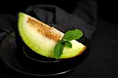 Frische Melone mit Minze
