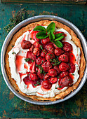 Pie with baked strawberries in a baking pan