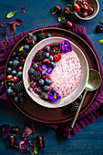 Purple smoothie bowl with blackberries and cherries