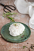 Vegan coconut 'labneh cheese' with with rosemary and colored pepper