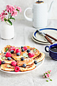 Fluffy pancakes with blueberries and raspberries