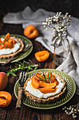 Gluten free tart with vegan cheese and apricots