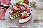 Vegan strawberry and pumpkin seed cake with pumpkin seed sponge and white nougat cream