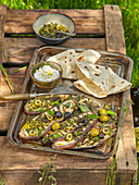 Marinated eggplant with olives and homemade tortillas