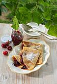 Pancakes with cherry jam
