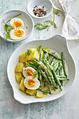 Green beans in mustard sauce with potatoes and egg