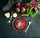 Beetroot risotto with hard cheese, caramelized leaves