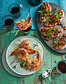 Prawns wrapped in bacon with bruscetta
