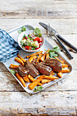 Fillet steaks with sweet potato chips