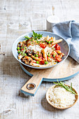 Penne with a mushroom and tomato ragout