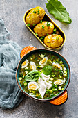 Cold sorrel soup with cucumbers, herbs and quail eggs (Russian soup)