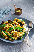 Rotini pasta with meatballs, asparagus and olives