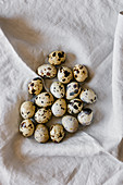 Quail eggs on linen background