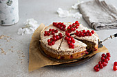 Redcurrant sponge cake with hazelnut meringue