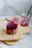 Cheesecake in a jar with berry ragout