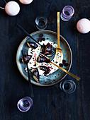 Chocolate shells with vanilla sauce