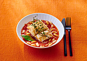 Cod with beans in tomato sauce