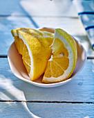 Lemon wedges in a white bowl