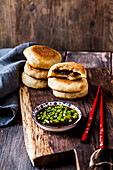Oriental-style stuffed pancakes with a spicy dip