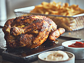 Roast chicken with chips and sauces