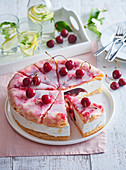 Cake with cherries and icing sugar