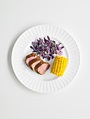 Jerk tenderloin with red cabbage salad and corn on the cob