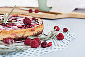 Baked New York cheesecake with raspberries and jam