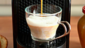 Coffee with milk on coffee machine