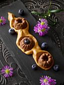 Chocolate panna cotta on Dalgona coffee foam made from malt coffee