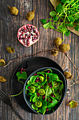 Purslane salad with kiwi and pomegranate seeds
